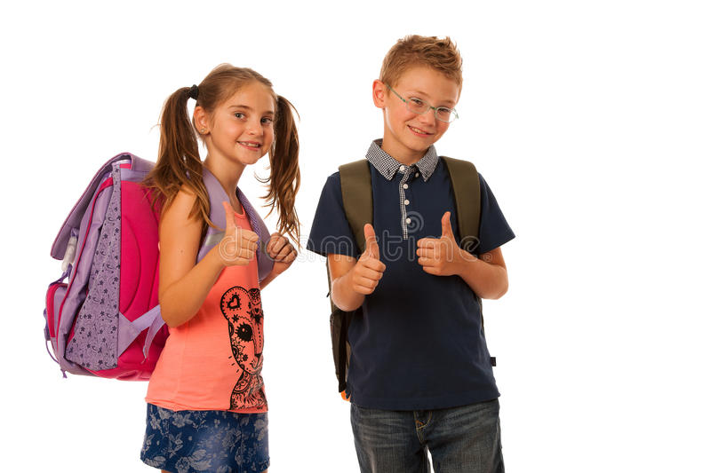 Schoolboy and schoolgirl with schoolbags isolated stock photography