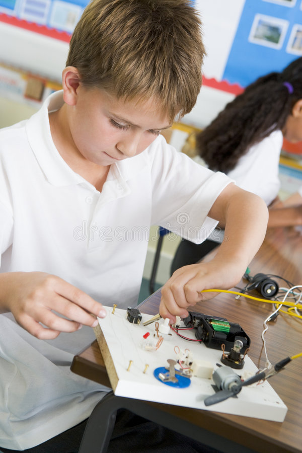 A schoolboy in a science class stock photos