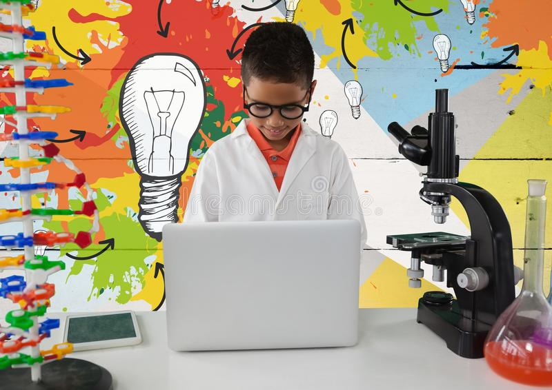 Schoolboy scientist in lab with colorful light bulbs background stock photos