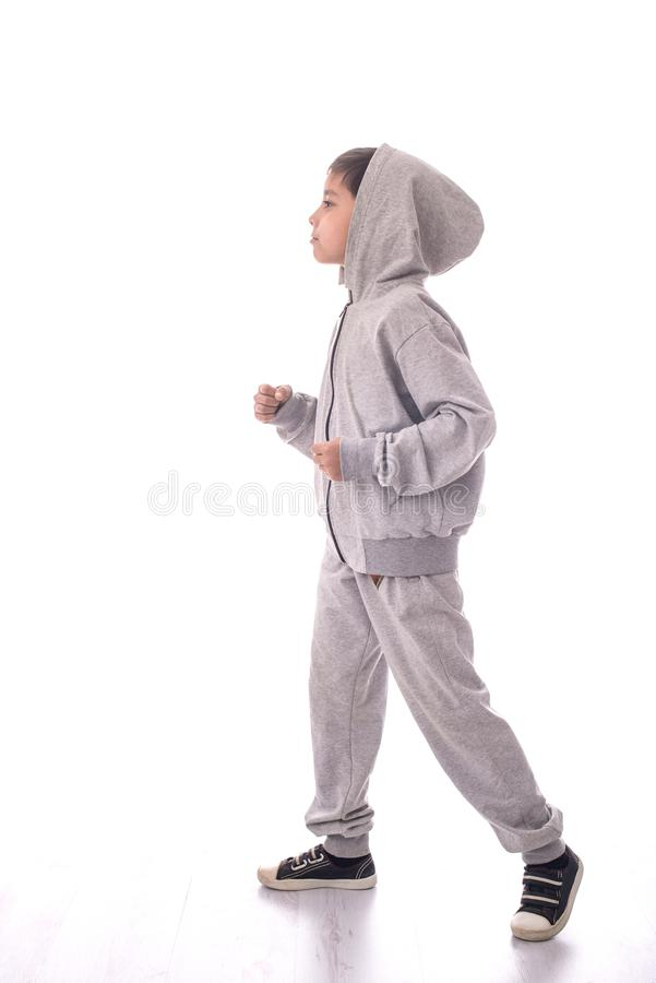 The boy in a sports suit goes royalty free stock photography