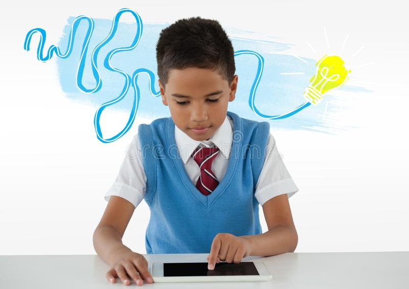 Schoolboy on tablet with colorful idea light bulb doodle stock image
