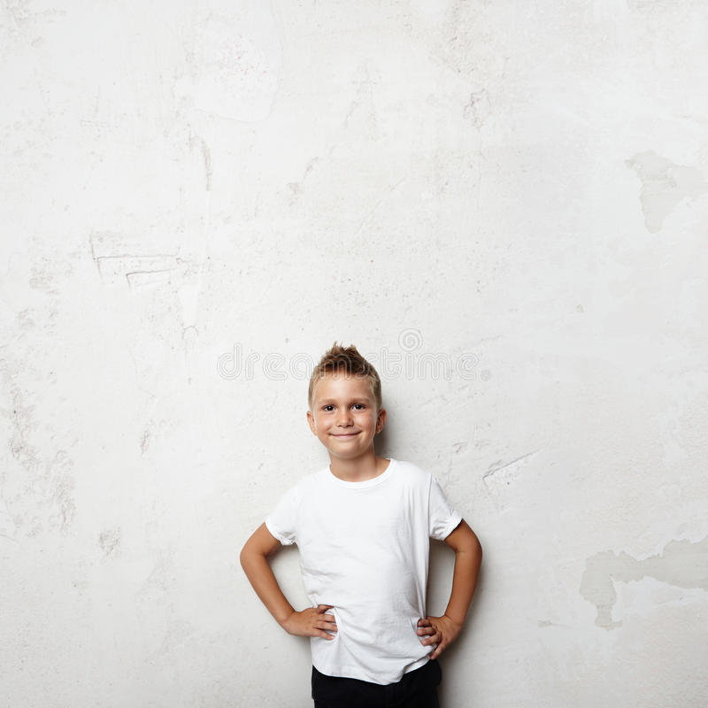 Schoolboy wearing white tshirt and smiling on the royalty free stock photo