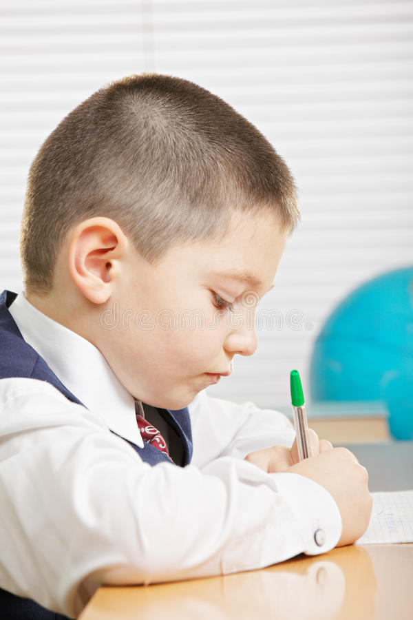 Download Schoolboy writing stock image. Image of copybook, busy - 26604155