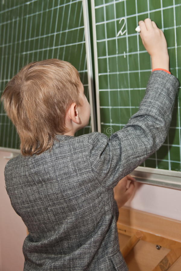 Download Schoolboy Writing Jn The Board Stock Image - Image: 16512781