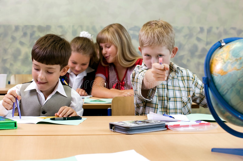 Download Schoolboys stock photo. Image of aiming, candid, desk - 3017444