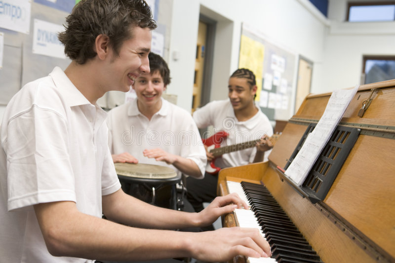 Download Schoolboys Playing Musical Instruments Stock Photo - Image: 6081528