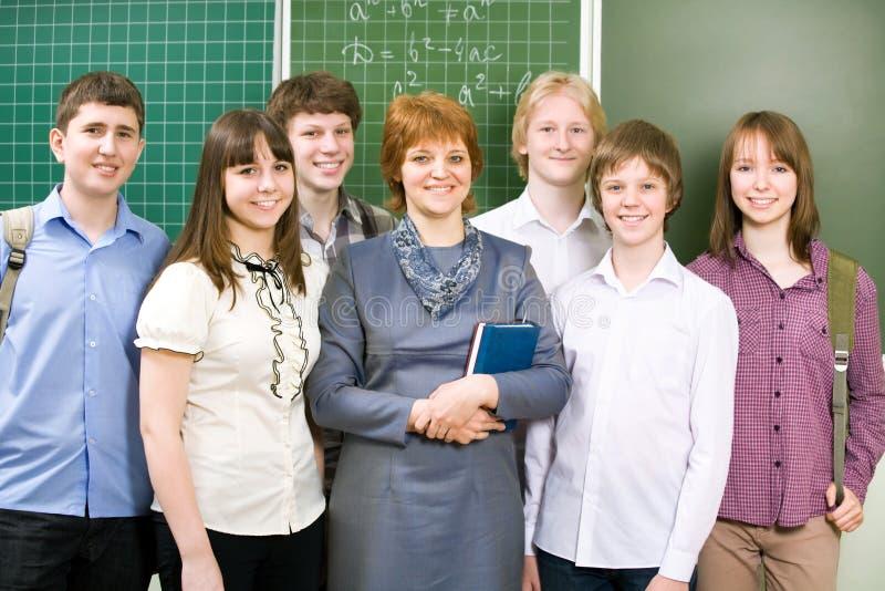 Schoolboys and schoolgirls with teacher royalty free stock photos