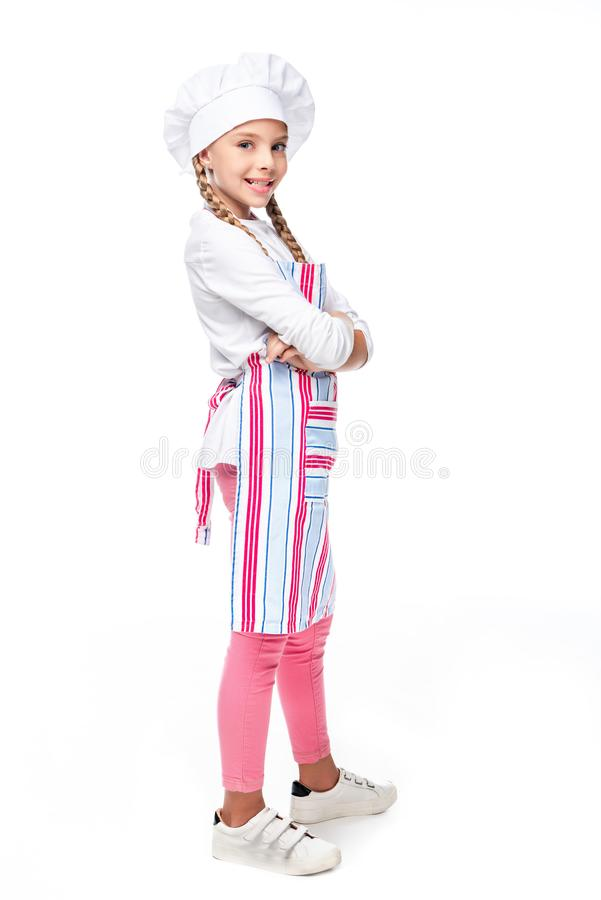 Schoolchild in costume of chef standing with crossed arms. Isolated on white stock images