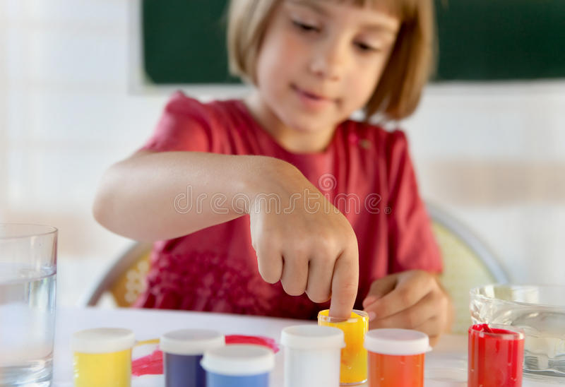 Schoolchild painting with hands