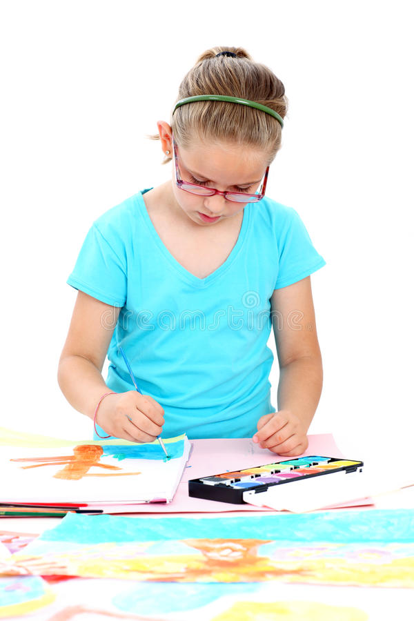 Schoolchild painting with watercolor stock images