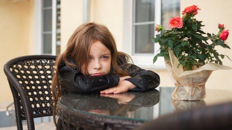 Schoolchild on terrace of summer cafe stock photography