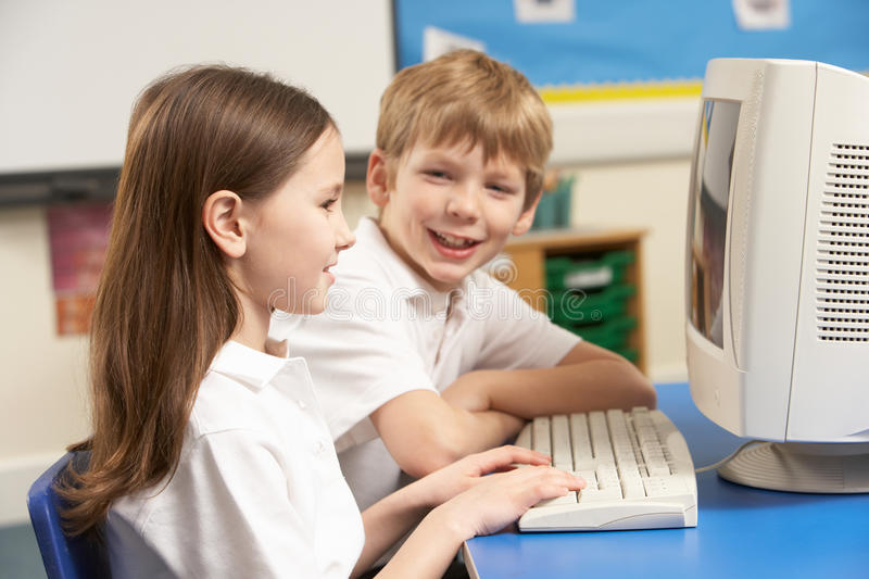 Schoolchildren In IT Class Using Computer royalty free stock image