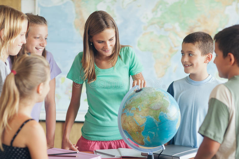 Download Schoolchildren In A Geography Lesson Stock Photo - Image: 34872796