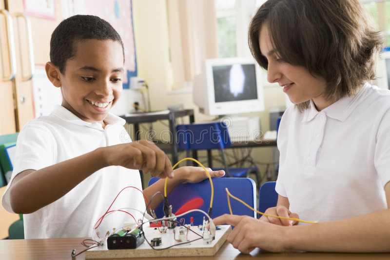 Schoolchildren in a science class royalty free stock images