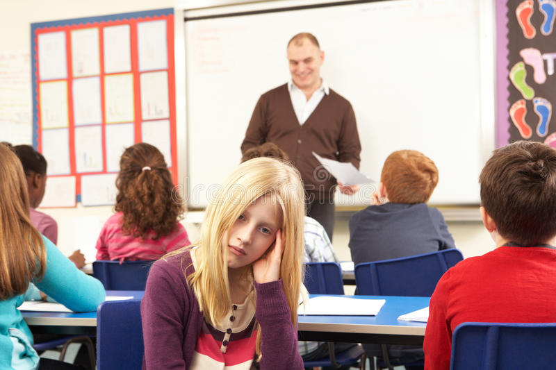 Schoolchildren Studying In Classroom With Teacher stock photography