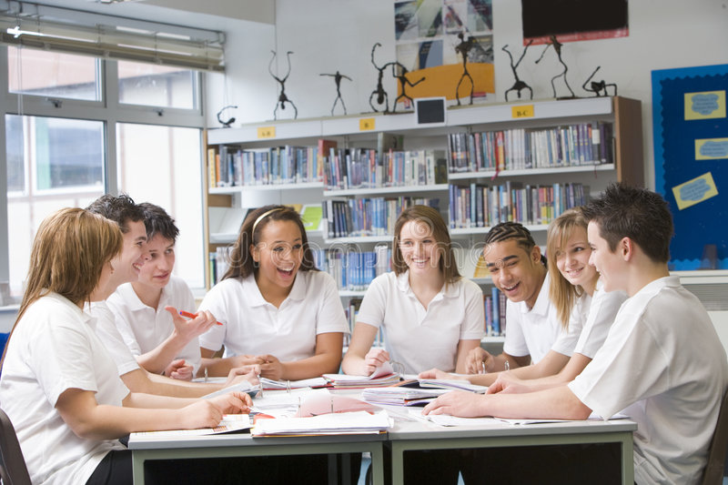 Schoolchildren studying in school library royalty free stock photo