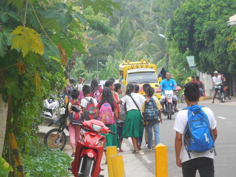 Streetview in Siquijor Phillipines. Schoolchildren on their way home in a street on Siquijor island Phillipines stock photo