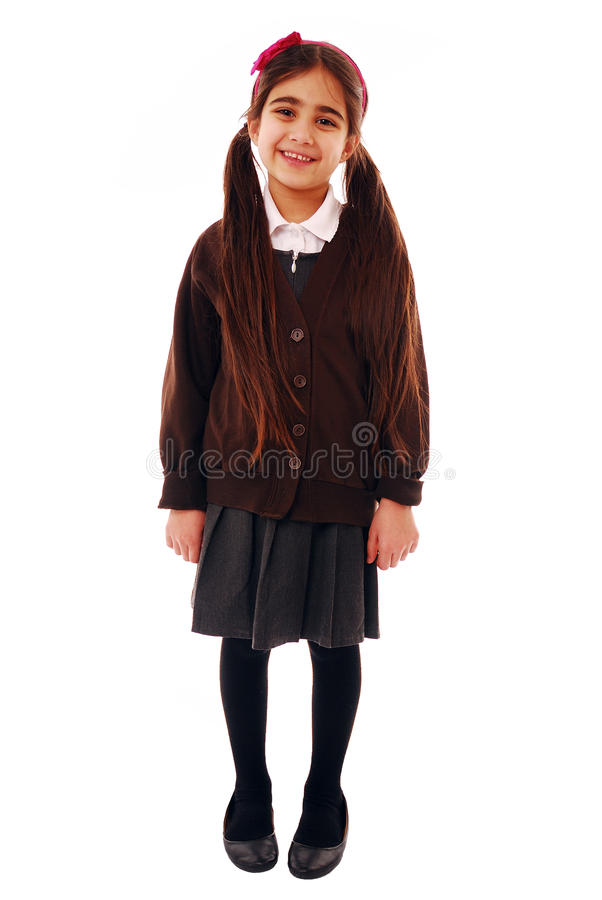 Schoolgirl. Asian schoolkid smiling isolated on white royalty free stock photos