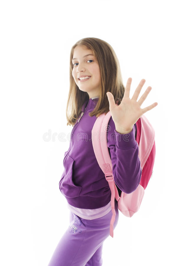 Schoolgirl With Backpack, Gesturing And Greeting Royalty Free Stock Image