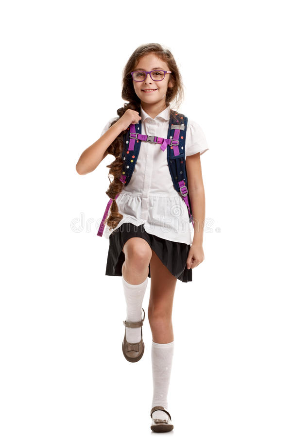 Schoolgirl with bag marching. Full portrait of happy cute girl with knapsack going to school royalty free stock images