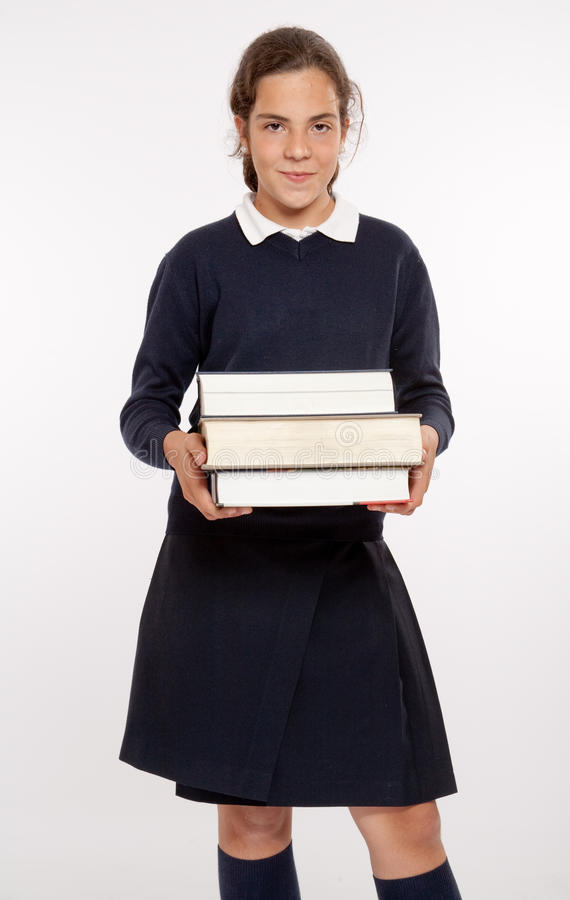 Download Schoolgirl with big books stock image. Image of learning - 26823921