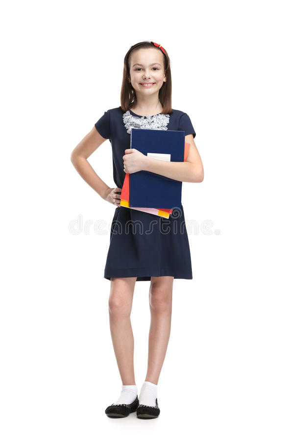Schoolgirl And The Books Royalty Free Stock Image