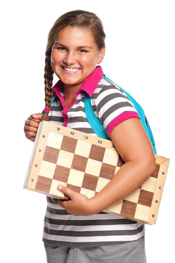 Schoolgirl with chessboard