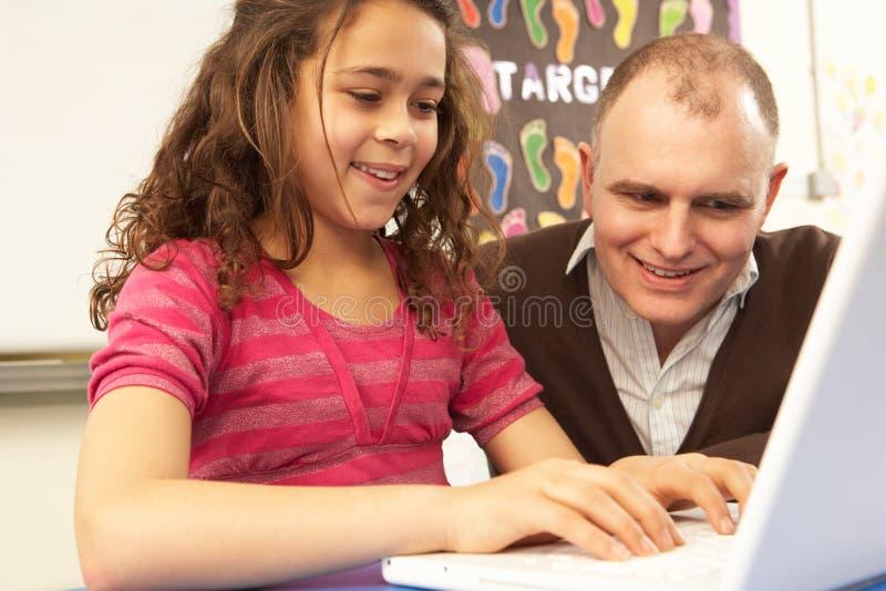 Download Schoolgirl In IT Class Using Computer With Teacher Stock Photo - Image of forties, listening: 18030564