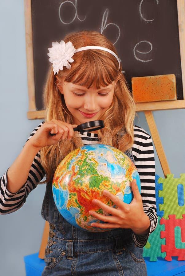 Schoolgirl In The Classroom Stock Images