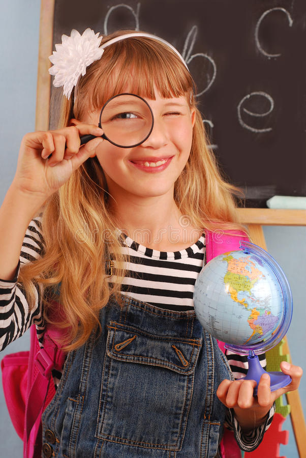 Download Schoolgirl In The Classroom Stock Image - Image: 20572357