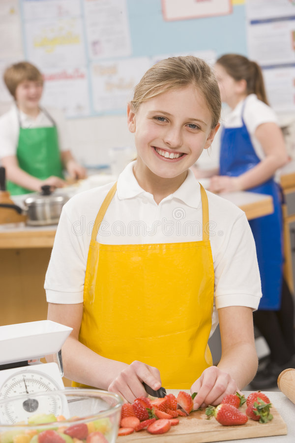 Schoolgirl in a cooking class stock photo