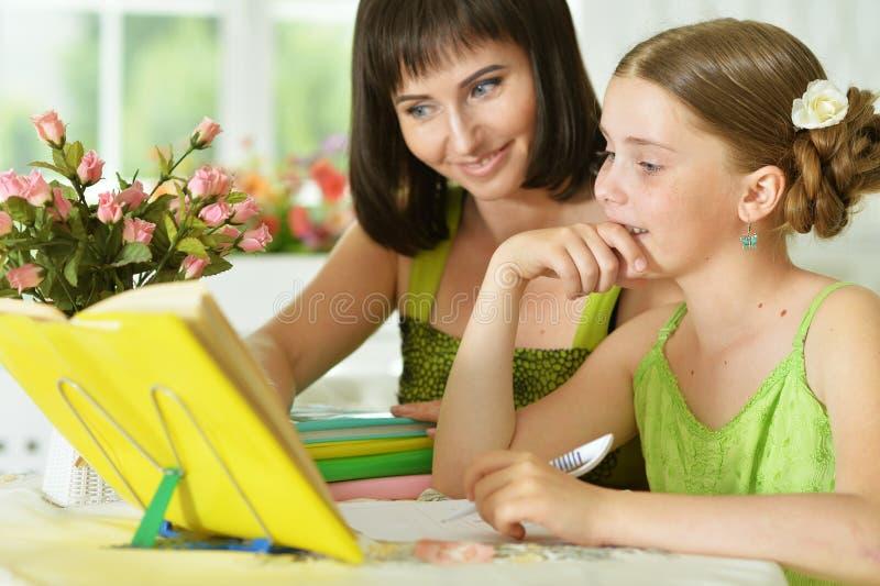 Schoolgirl doing homework royalty free stock images