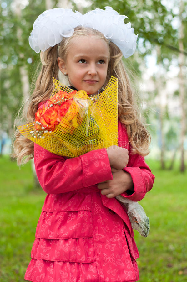 Schoolgirl Dressed With A Bouquet Stock Photo