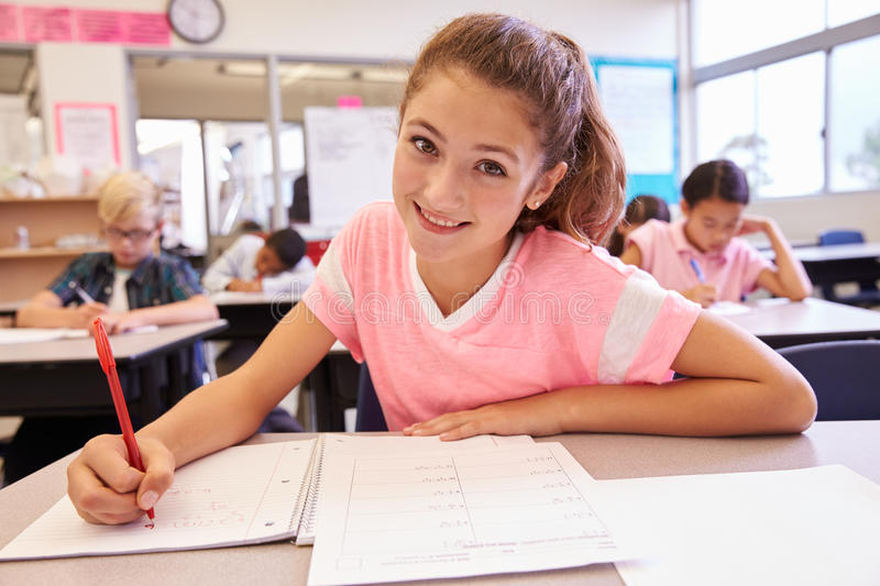 Schoolgirl in an elementary school class looking at camera stock photography
