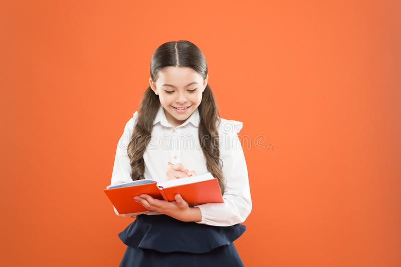 Schoolgirl enjoy study. Kid school uniform hold workbook. School lesson. Child doing homework. Your career path begins. Here. Write essay or notes. Inspiration royalty free stock images