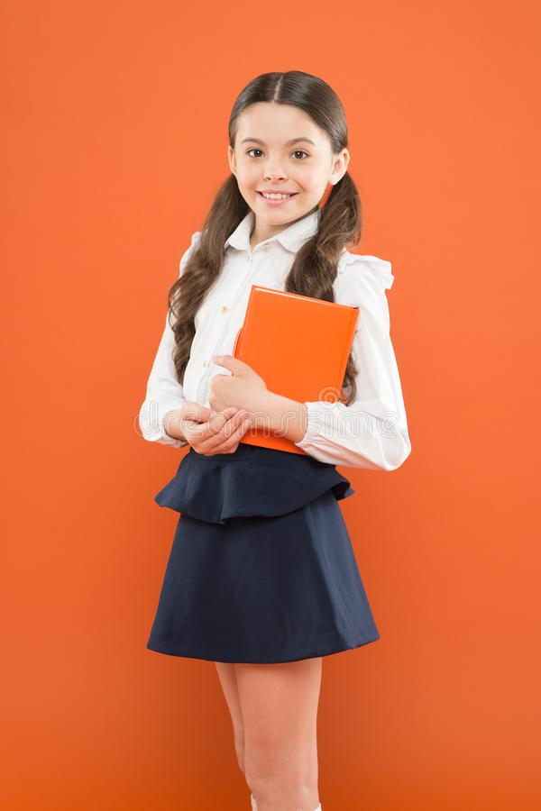 Schoolgirl enjoy study. Kid school uniform hold workbook. School lesson. Child doing homework. Believe in possibilities. Inspiration for study. Back to school royalty free stock photos