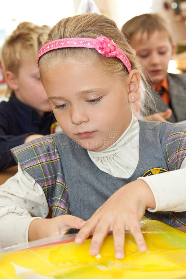 Download Schoolgirl With A Folder In Classroom Stock Image - Image: 16292139