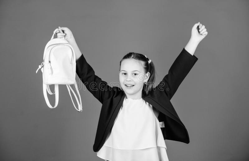 Schoolgirl formal style clothes with small cute backpack. Do not forget your backpack. Learn how fit backpack correctly. Girl little fashionable cutie carry stock image