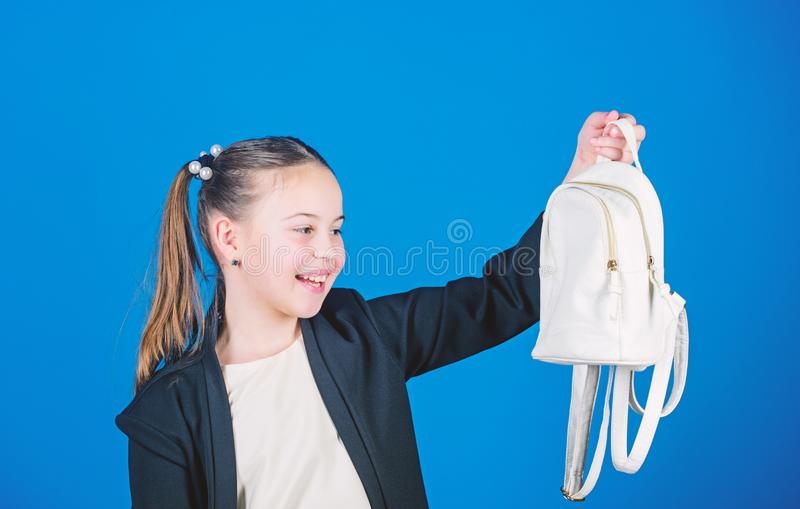 Schoolgirl formal style clothes with small cute backpack. Learn how fit backpack correctly. Girl little fashionable. Cutie carry backpack. Kids fashion trend royalty free stock image
