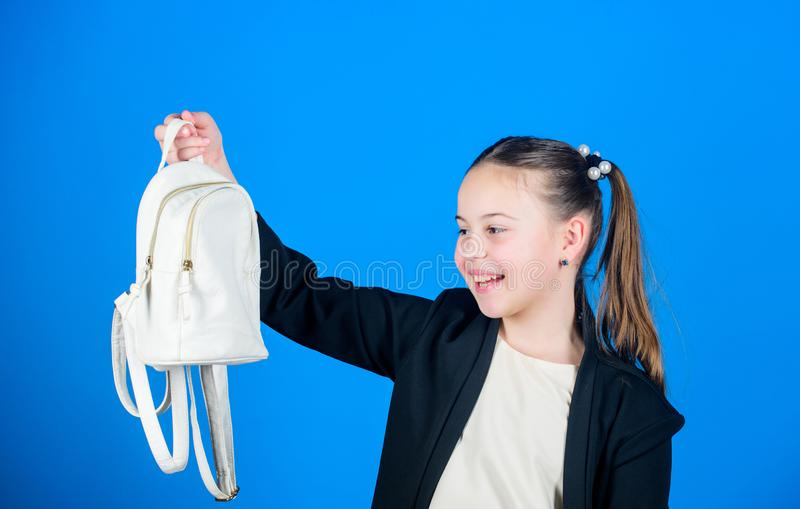 Schoolgirl formal style clothes with small cute backpack. Learn how fit backpack correctly. Girl little fashionable. Cutie carry backpack. Kids fashion trend royalty free stock photography