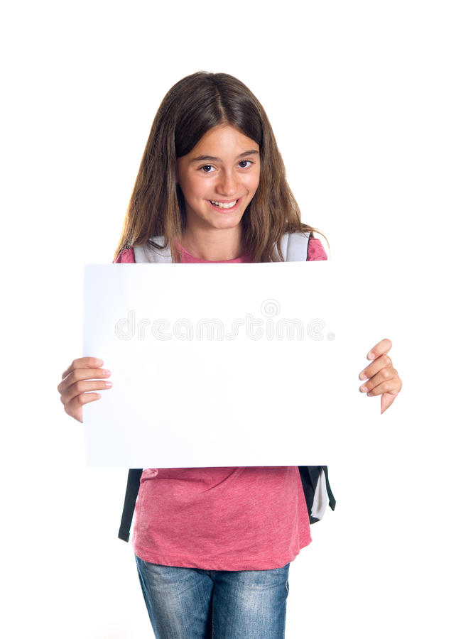 Schoolgirl holding blank paper royalty free stock photo