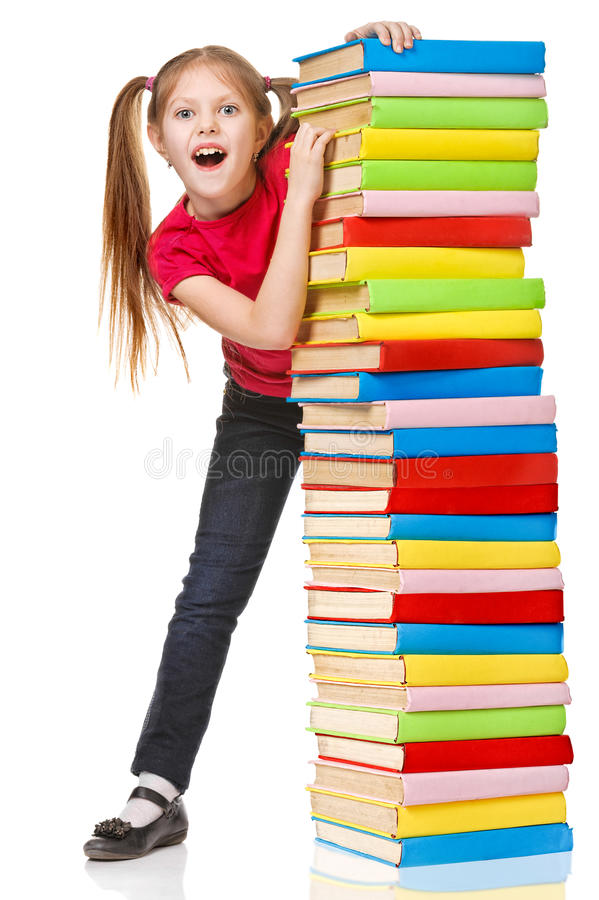 Schoolgirl holding pile of books. Isolated. Over white stock photography