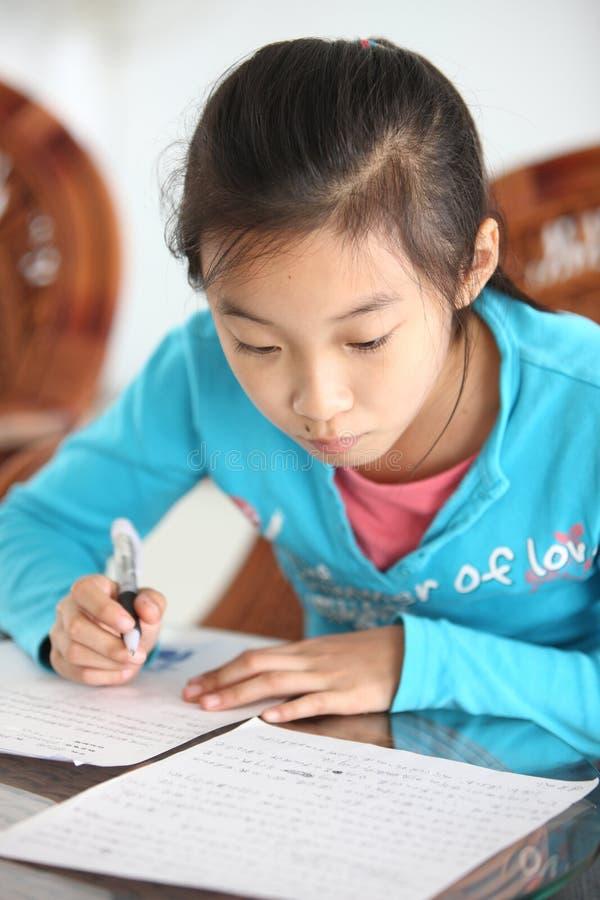 Download Schoolgirl homework stock image. Image of read, education - 23571357