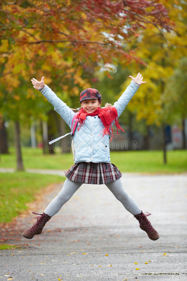 Download Schoolgirl jumping stock image. Image of charming, emotional - 34640489