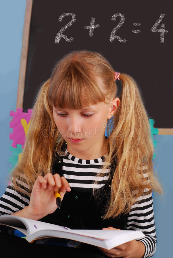 Schoolgirl learning in the classroom