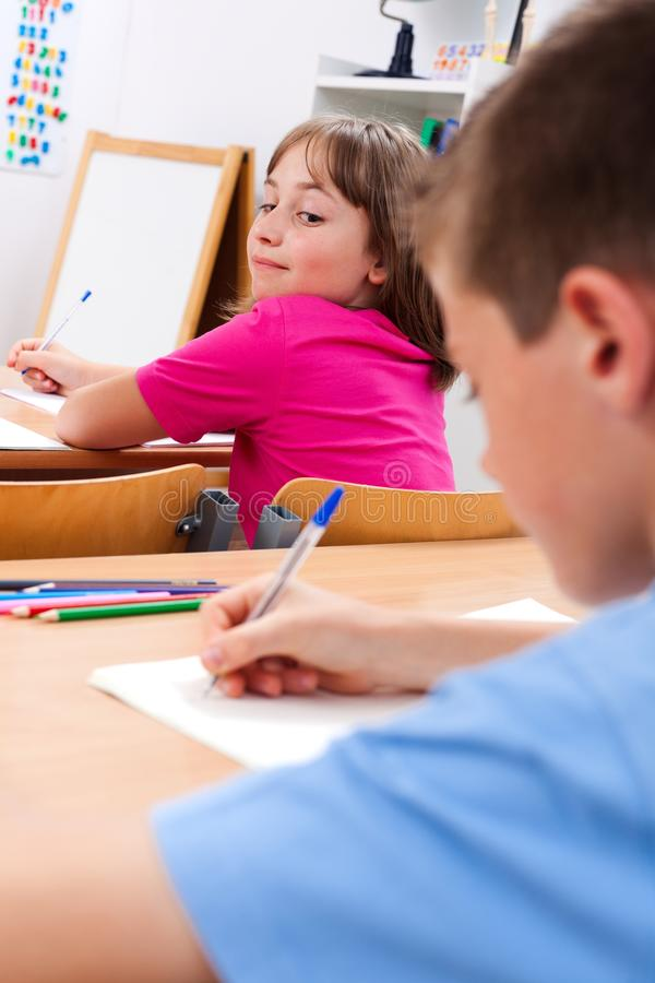 Download Schoolgirl Looking At Colleague's Test Stock Image - Image: 20426013