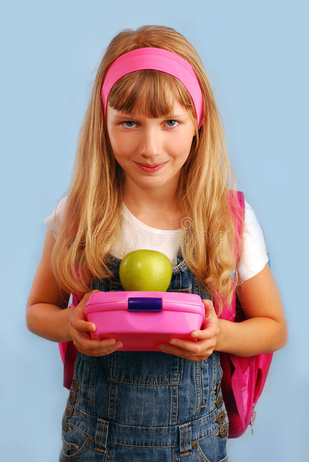 Download Schoolgirl With Lunch Box And Apple Stock Photo - Image of longhair, pupil: 20788158