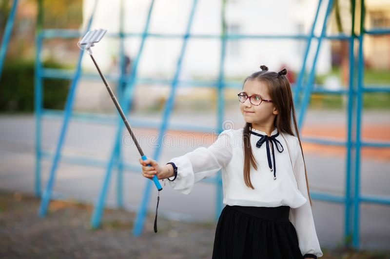 Schoolgirl making selfie royalty free stock image
