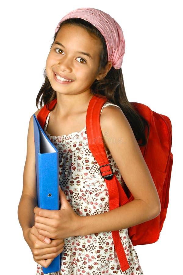 Schoolgirl med den blåa mappen fotografering för bildbyråer