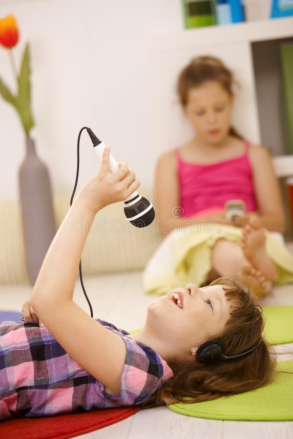 Download Schoolgirl With Microphone And Headphones Stock Photo - Image: 18493210
